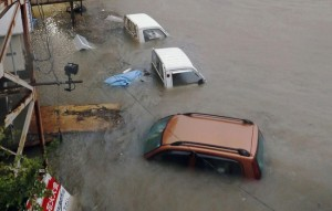 Stranded cars are seen in floodwater caused by Typhoon Halong in Kochi