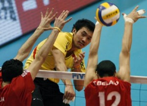Thailand's Tabwises spikes the ball past Algeria's Ali and Toufik during their 2008 World Men's Olympic Volleyball Qualification Tournament in Tokyo