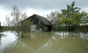 A view of a house in the midst of floodwater in Zazina village