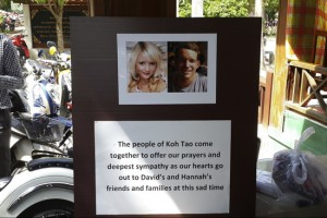 Pictures of killed British tourists David Miller and Hannah Witheridge and a message of support to their friends and families are displayed during special prayers at Koh Tao island
