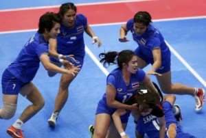 Thailand's players tackles Japan's Kaneko during their women's preliminary kabaddi match at the 17th Asian Games in Incheon