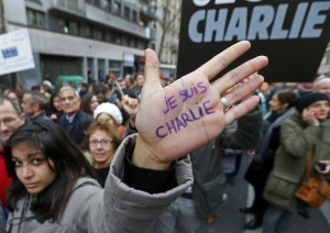 """A woman with """"I'm Charlie"""" written on her hand takes part in a Hundreds of thousands of French citizens solidarity march (Marche Republicaine) in the streets of Paris"""