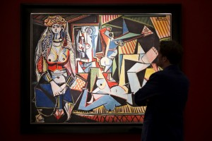 """Man pauses to look at Pablo Picasso's """"Les femmes d'Alger (Version 'O')"""" at a media preview for Christie's in the Manhattan borough of New York"""