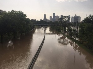 Flood waters cover Memorial Drive along Buffalo Bayou in Houston