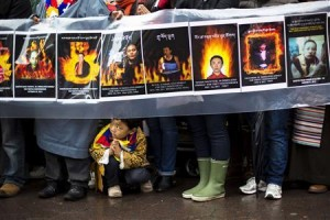 File photo of a child gesturing at feet of protesters during solidarity march from Chinese Consulate to UN Headquarters in support of Tibet in New York