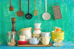 collection of vintage kitchenware, green wall  background