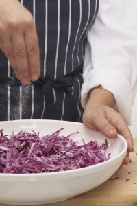 Salting red cabbage, close-up